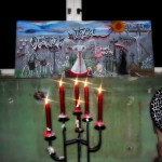 Kerzen und Friedhofsbild